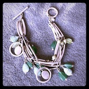Express. Silver & green bead bracelet with toggle